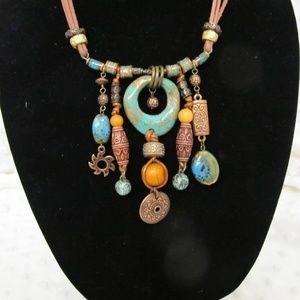 Chico's copper-tone and leather straps